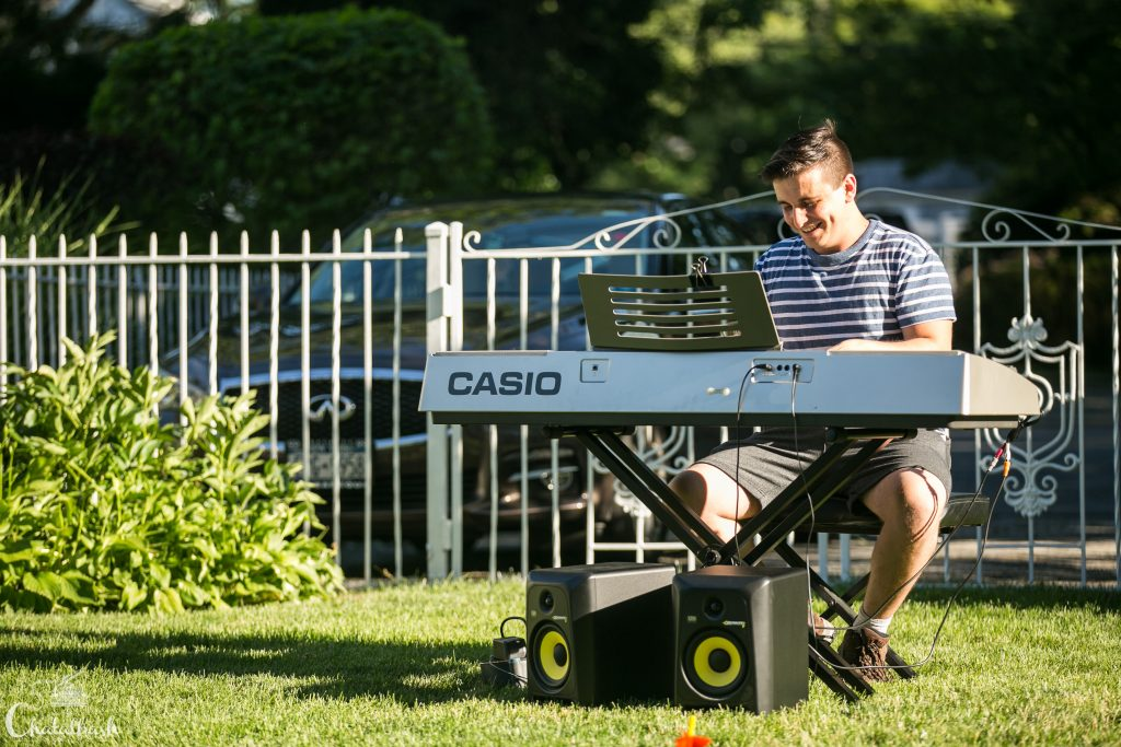 piano student playin outside at recital